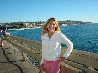 Woman standing on pier in front of ocean