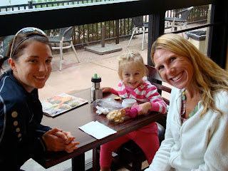 Two women and young girl in coffee shop