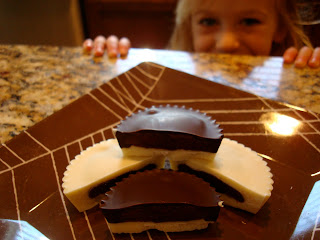 Peanut Butter Cups on plate with young girl peaking over counter