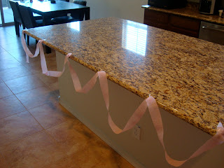 Countertop decorated with pink streamer
