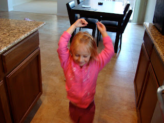 Young girl dancing in kitchen