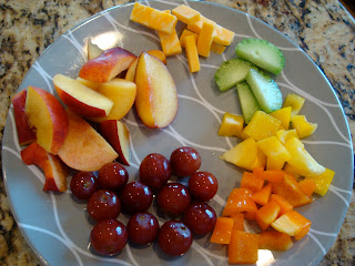 Plate full of mixed vegetables and fruit with cheese