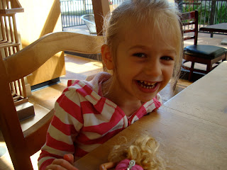 Young girl laughing at table