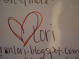 Drawing on white board with heart symbol and the name Lori
