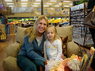 Woman and child sitting in overside chair in grocery store