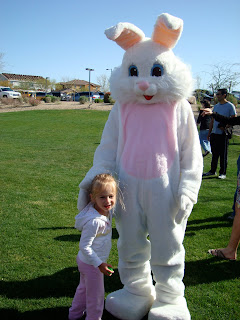 Young girl standing in front of easter bunny