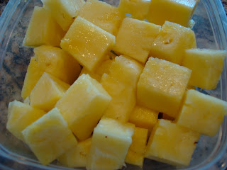 Diced up pineapple in clear container