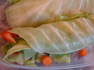 Up close of Cabbage Wraps in clear container