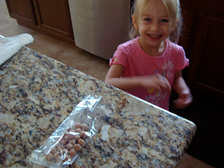 Young girl reaching for pretzel bites on countertop