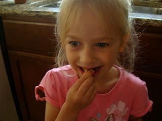 Young girl eating one Gourmet Cinnamon Sugar Pretzel Bite