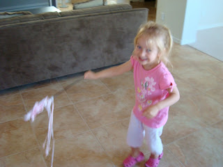 Young girl in pink dancing with princess wand