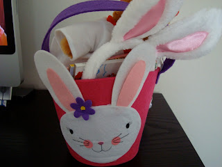 Easter Basket with bunny on front fully of gifts