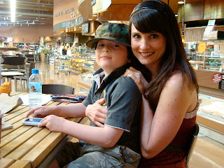 Woman smiling with young boy on lap
