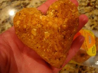 Heart shaped Heart Thrive Date Bar in hand