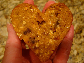 Close up of hand holding heart shaped bar