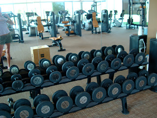 Gym showing rows of dumbbells