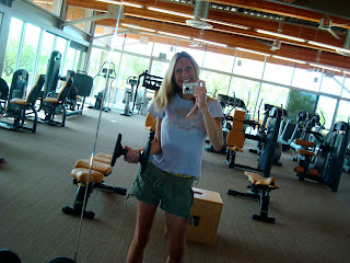 Woman lifting dumbbells in mirror