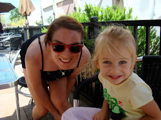 Woman leaning over posing with child smiling