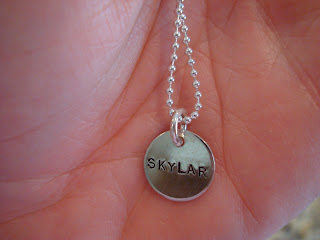 Up close of necklace with the name Skylar