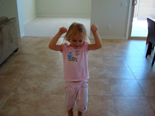 Young girl in pink shirt dancing