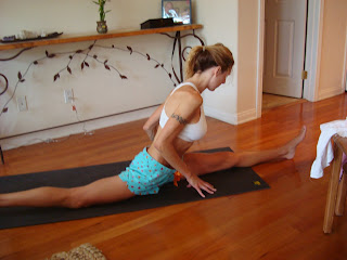 Side view of woman doing Hanumanasana yoga pose