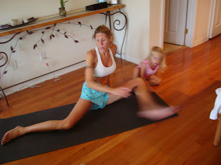 Woman with young girl doing yoga