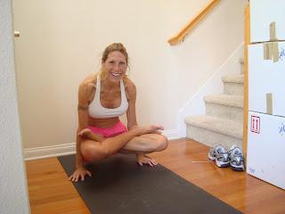 Woman doing the Tolasana yoga pose