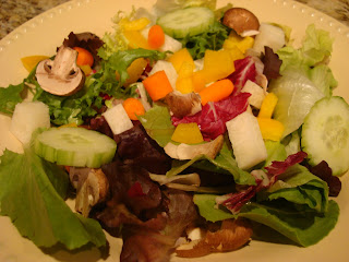 Mixed vegetable salad in round white bowl