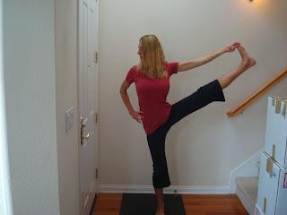 Woman doing Utthita Hasta Pandungustasana out to the side yoga pose