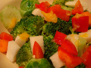 Chopped vegetables mixed together in clear container