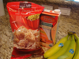 Bag of rice and bean chips, container of almond milk and bananas