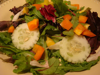 Mixed vegetable and green salad in shallow white bowl