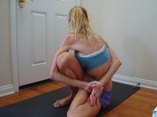Woman doing Marichyasana D yoga pose