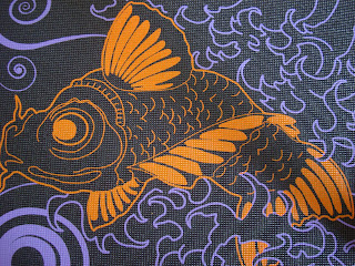 Orange fish on yoga mat surrounded by purple designs