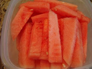 Sliced up watermelon in clear container