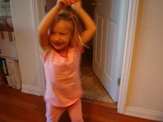 Young girl doing a happy dance