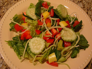 Mixed greens with broccoli slaw and mixed vegetables in white shallow bowl