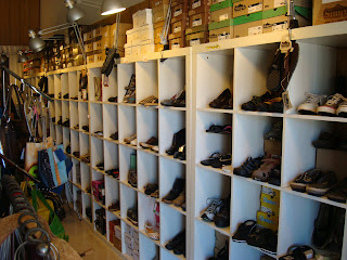 Stacked shoes in cubbies inside Vegan store