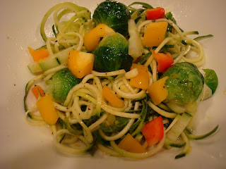 Zuke Noodles tossed with mixed vegetables white bowl