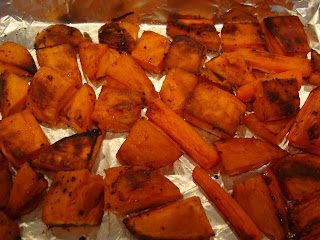 Roasted sweet potatoes and carrots in baking pan