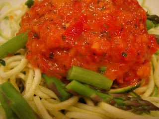 Close up of Zucchini Noodles topped with asparagus spears and marinara sauce