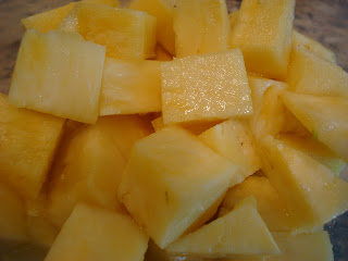 Diced pineapple in clear container