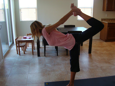 Woman doing Natarajasana yoga pose