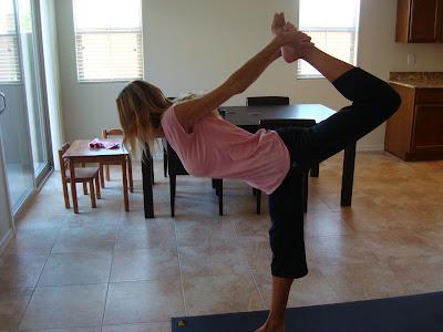 Woman doing Natarajasana yoga pose