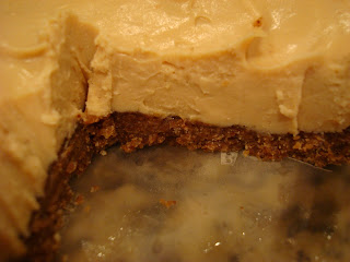Raw Vegan Cheesecake in container with slice cut out