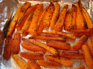 Roasted Sweet Potatoes and Carrots in foil lined pan out of oven