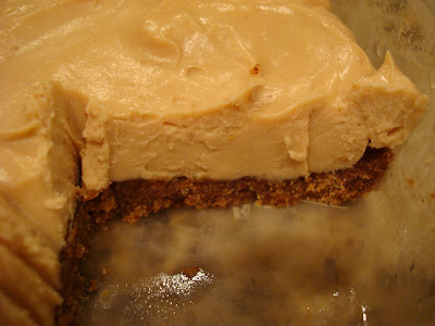 Raw Vegan GF Cheesecake in container with slice taken out