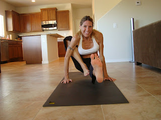 Woman doing loating version of Maricyasana A yoga pose