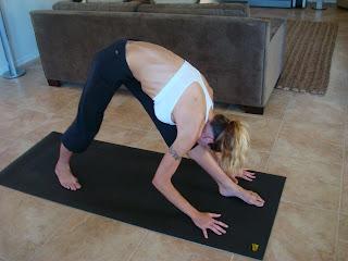 Woman doing Parsvottanasana yoga pose
