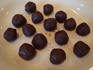 Overhead of Raw Vegan Chocolate Donut Holes on white plate